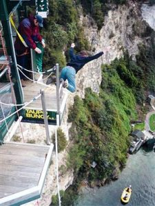 Adrian pictured bungee-jumping in New Zealand