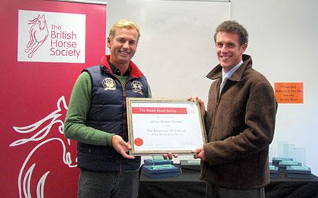 Adrian receives BHSI certificate
